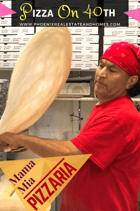 A man is flipping the pizza dough in the pizza on 40th