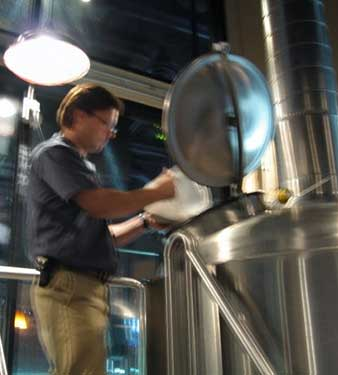 Brian Helpton (owner of Helton Brewing Company adds ingredients to the locally famous Helton beer brew..