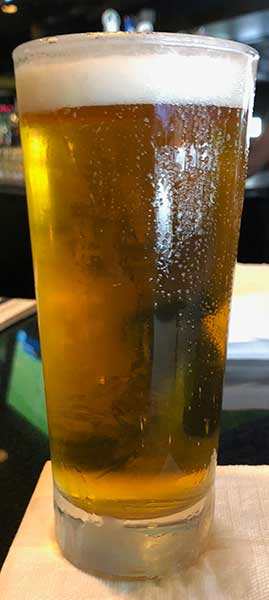 Cold tall glass with IPA on draft