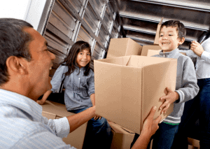 Moving Containers vs Trucks and family with children choosing Moving Trucks for their means of home relocation