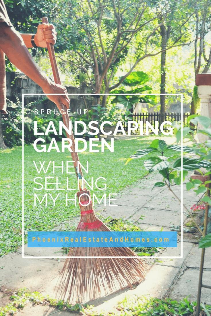 A man raking his beautiful landscaping garden