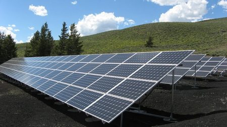 Solar power array under the sun that contributes green power energy