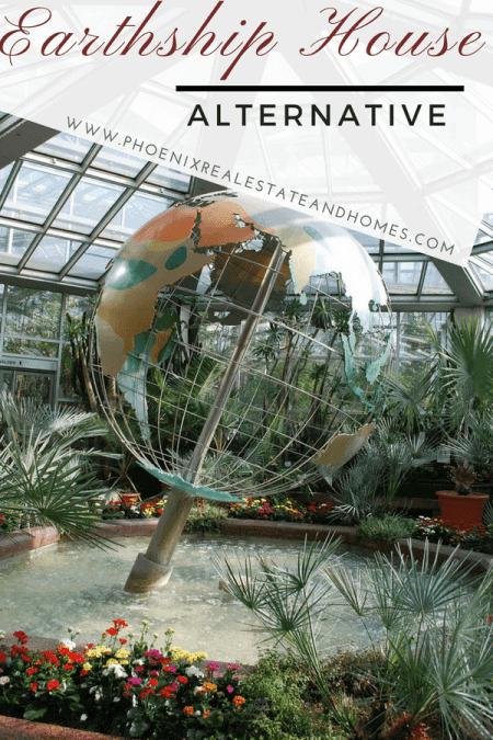 A greenhouse earthship house with a globe inside